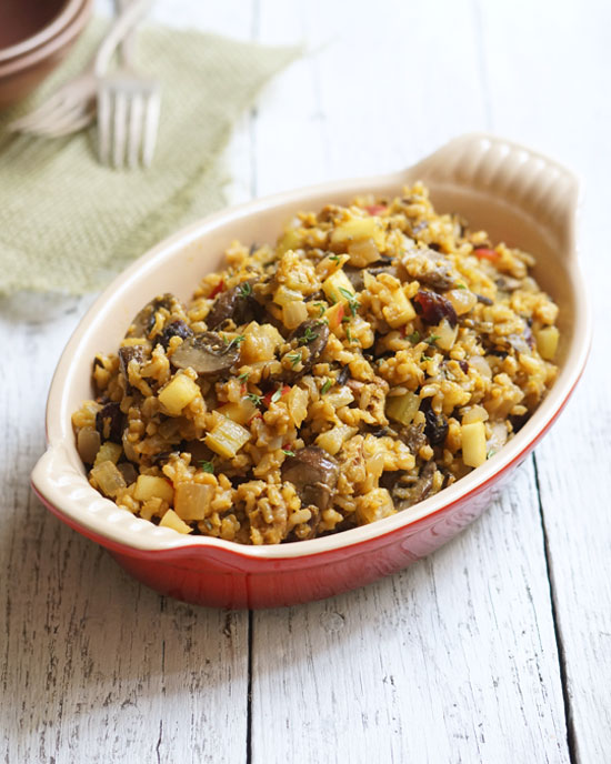wild rice and mushroom stuffing in a red serving dish