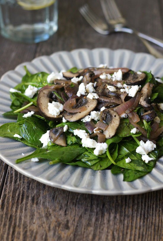 warm mushroom and spinach salad on a plate