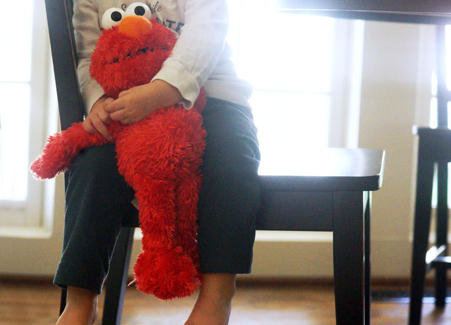 toddler hugging elmo