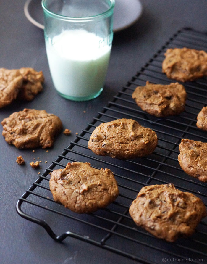 cooling rack with chickpea chocolate chip cookies and a glas of milk