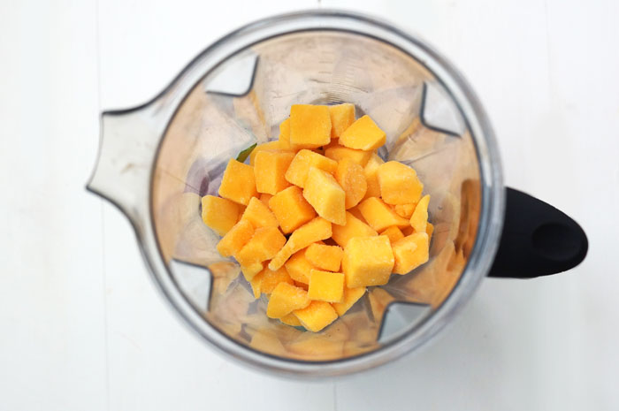 blender with mango chunks in it
