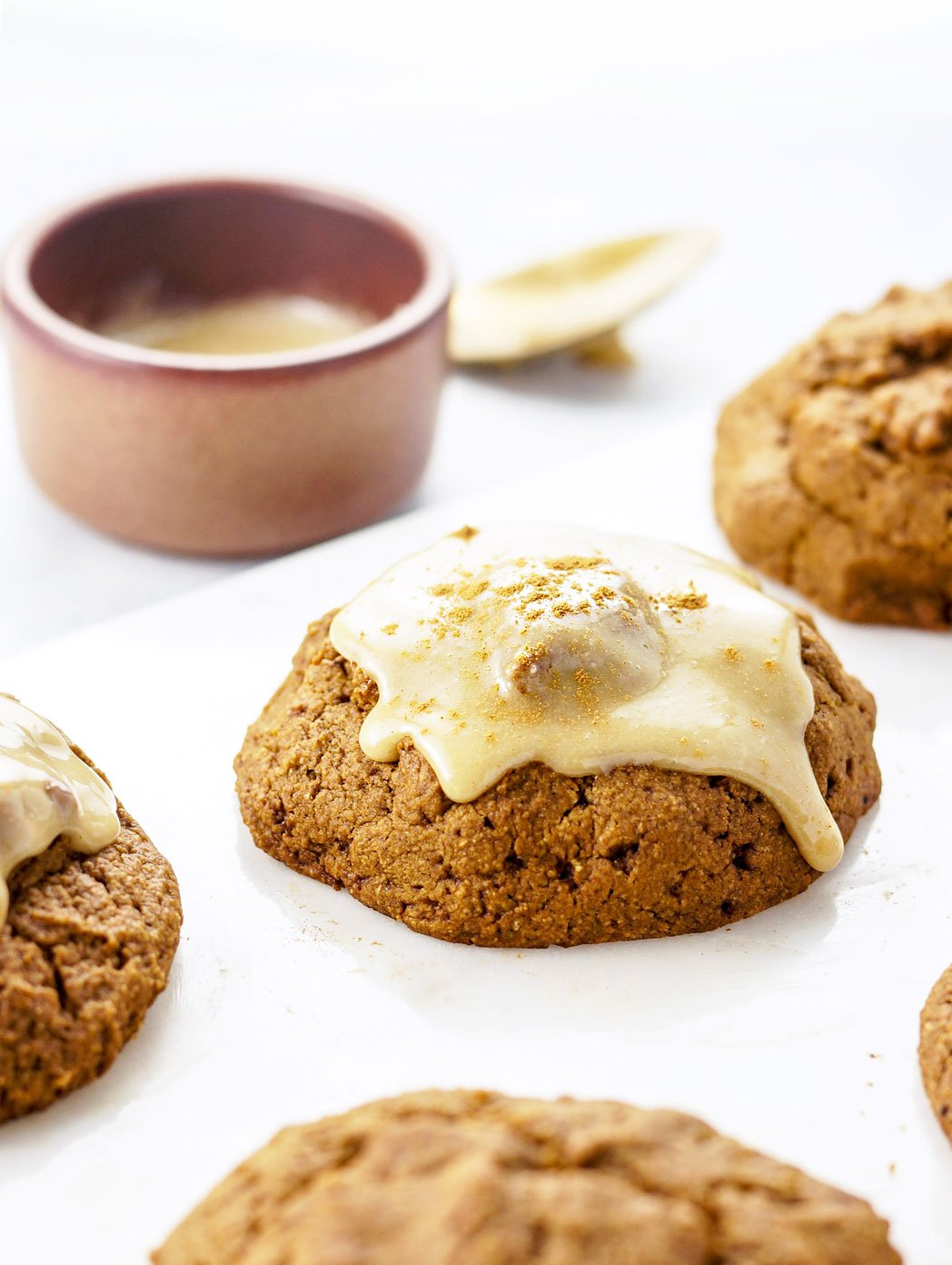 pumpkin scones with creamy maple glaze on top