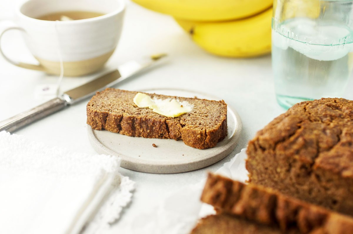 slice of almond flour banana bread with butter on top