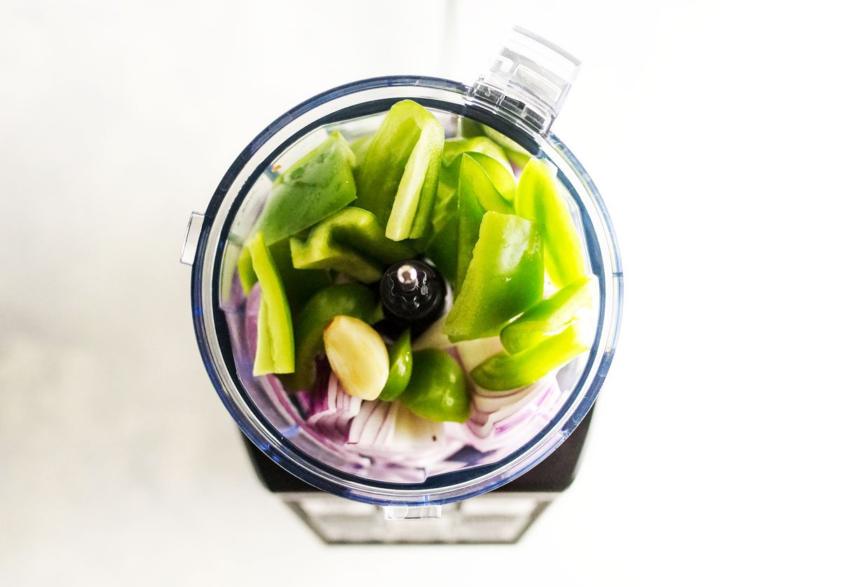 red onion, green pepper, and garlic in a ninja blender