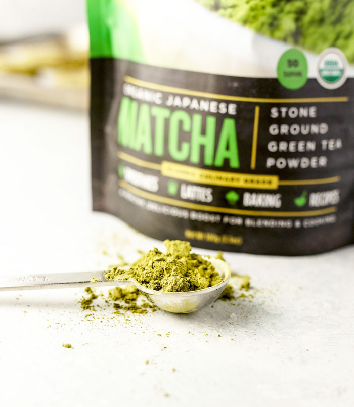 scoop of matcha powder in a measuring spoon