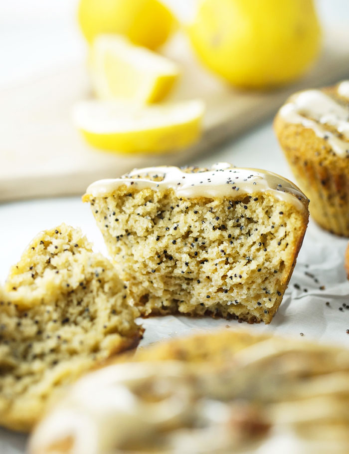 coconut flour lemon poppyseed muffin with lemon icing broken in half