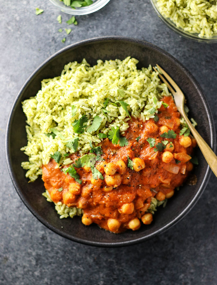 vegan chickpea tikka masala with green rice in a bowl