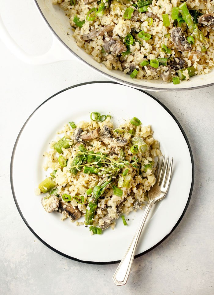 Vegan Cauliflower Rice Risotto with Asparagus and Mushrooms on a plate
