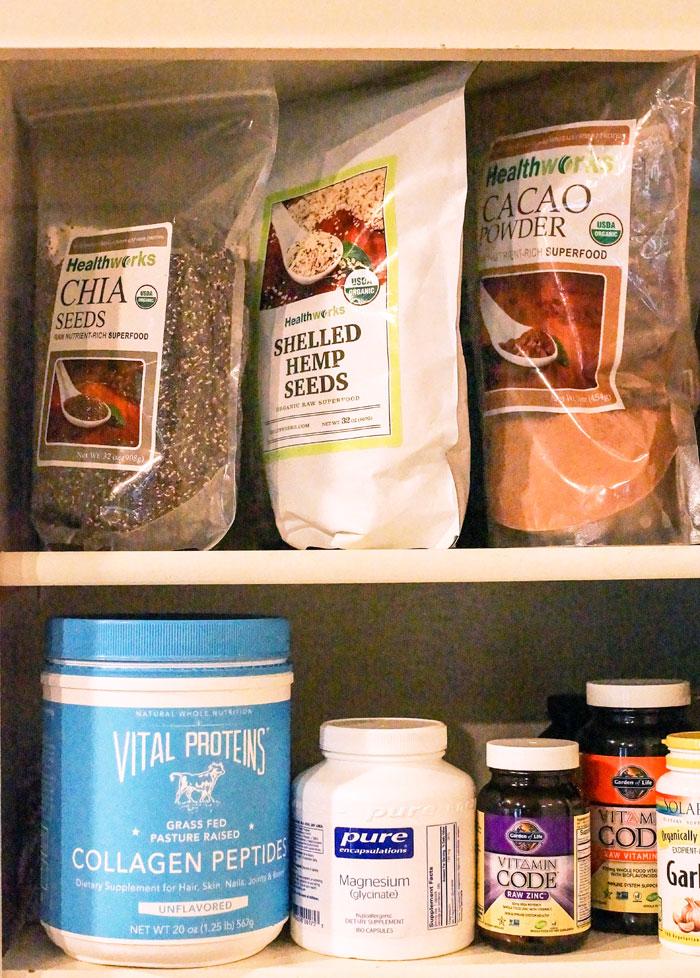 chia seeds, shelled hemp seeds, cacao powder, and vitamins on shelves