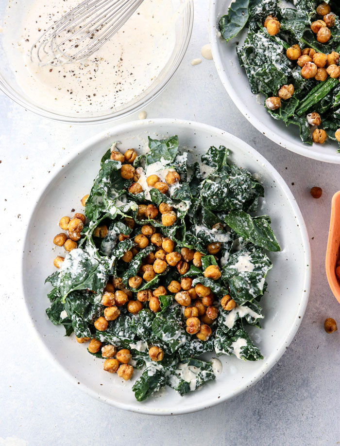 bowl of vegan kale salad with roasted chickpeas