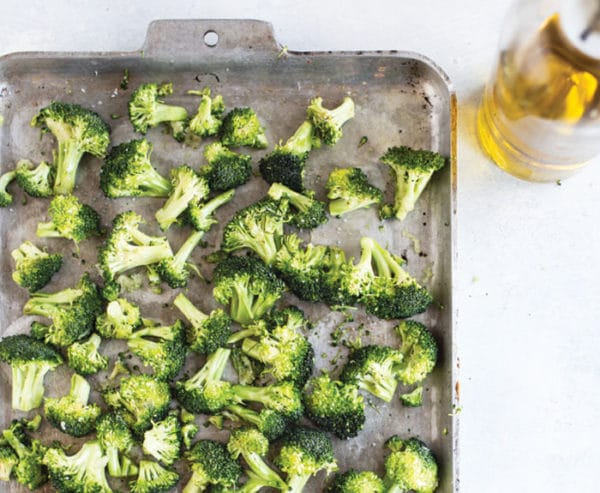 roasted broccoli on a pan with olive oil
