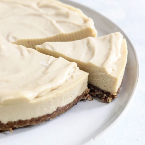 whole vegan cheesecake with slice taken out