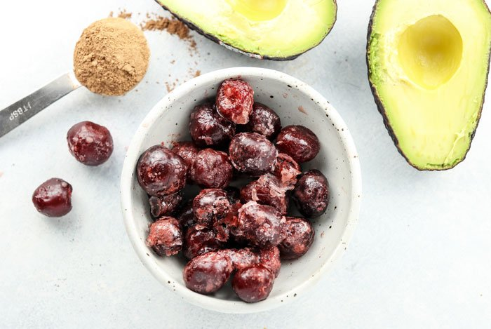 cherries, avocado, and cocoa powder