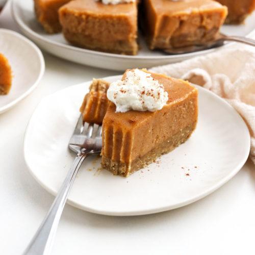 vegan pumpkin cheesecake with fork marks
