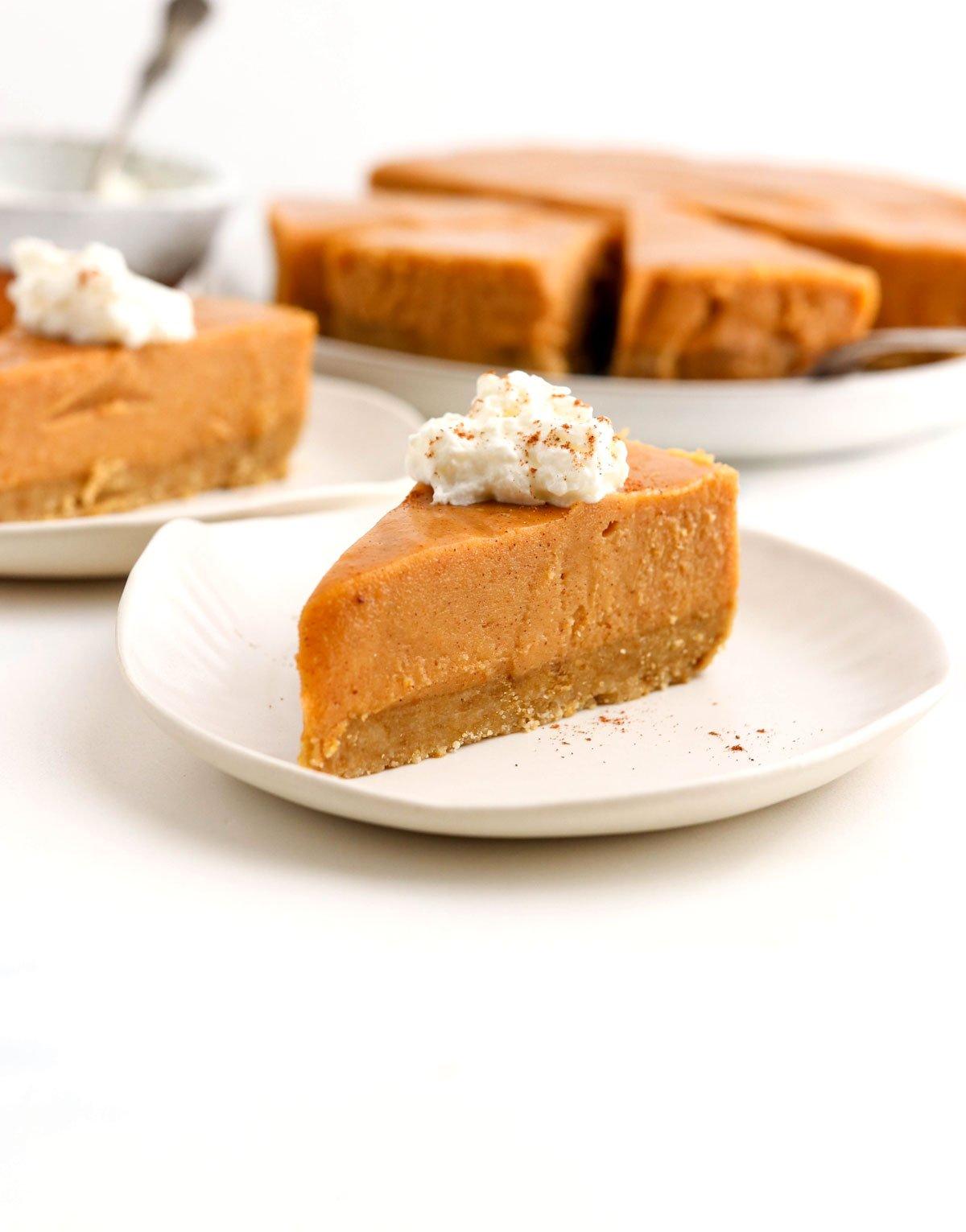 slice of vegan pumpkin cheesecake on plate