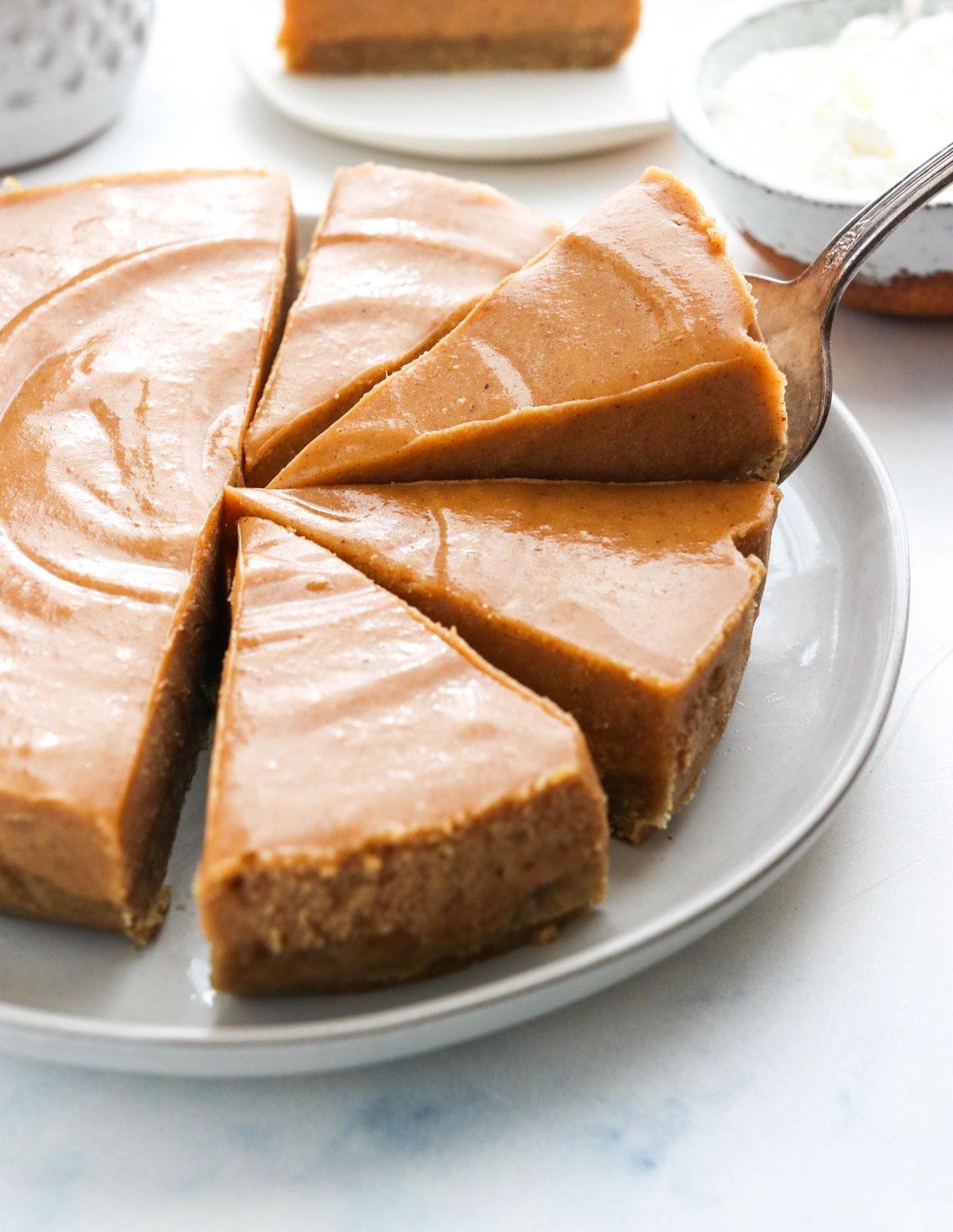 sliced pumpkin cheesecake lifted up