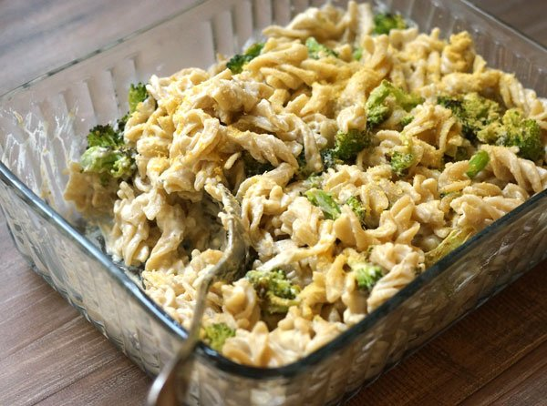 vegan mac'n cheese with broccoli in a serving dish
