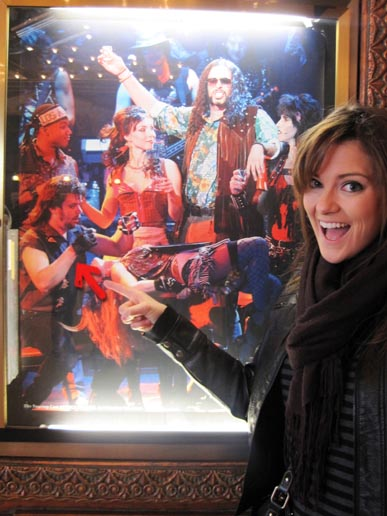 detoxinista in front of rock of ages poster