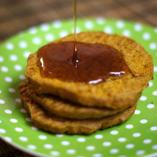pouring syrup on flourless pancakes