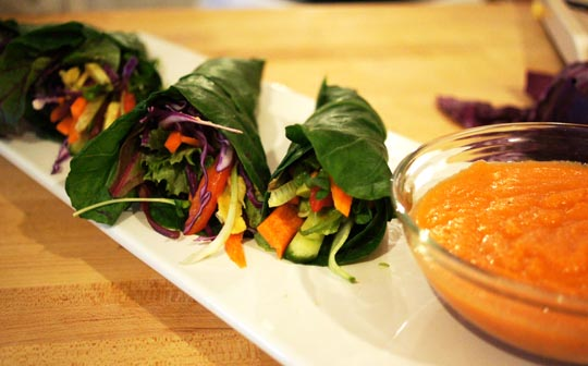 Collard wraps, with a carrot-miso dipping sauce.