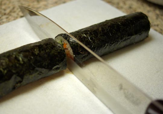 cutting sushi roll