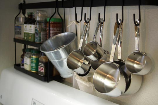 measuring cups hanging on hooks