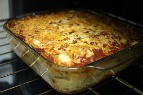 pan of eggplant and goat cheese lasagna in the oven