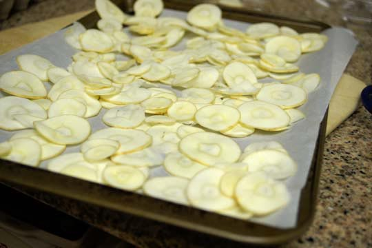 parsnip slices on a pan