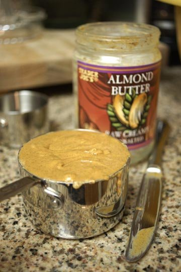 almond butter in a measuring cup