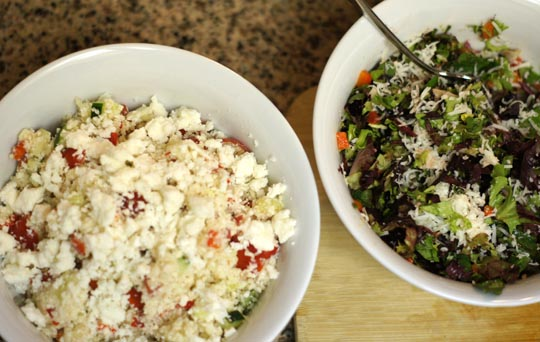 Mixed Green salad with Raw Cauliflower Couscous in a bowl