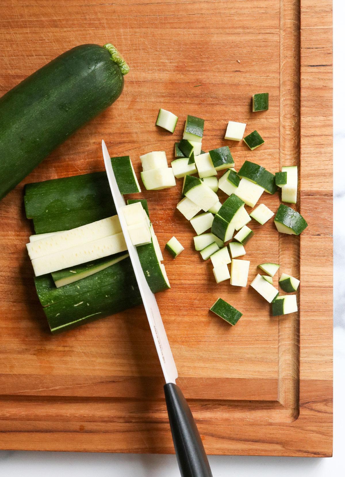zucchini diced on cutting board