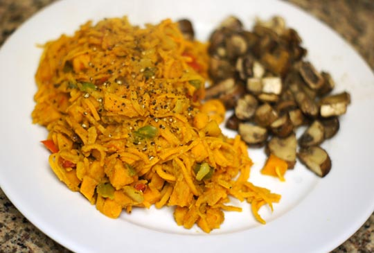 plate of curry noodles with mushrooms