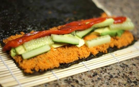 making vegetable sushi rolls