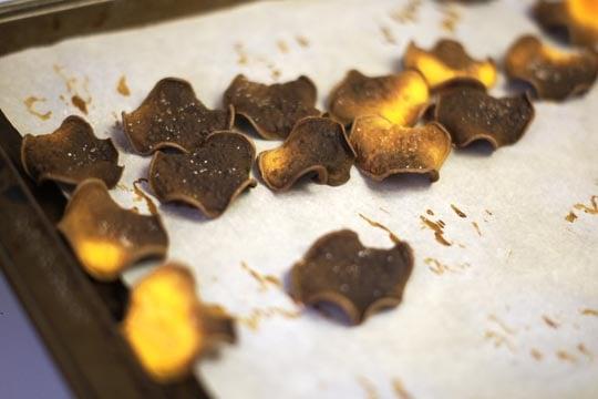 burnt sweet potato chips on a pan