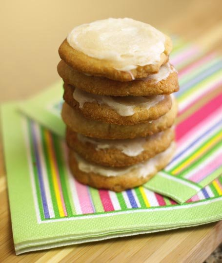 stack of frosted almond flour sugar cookies