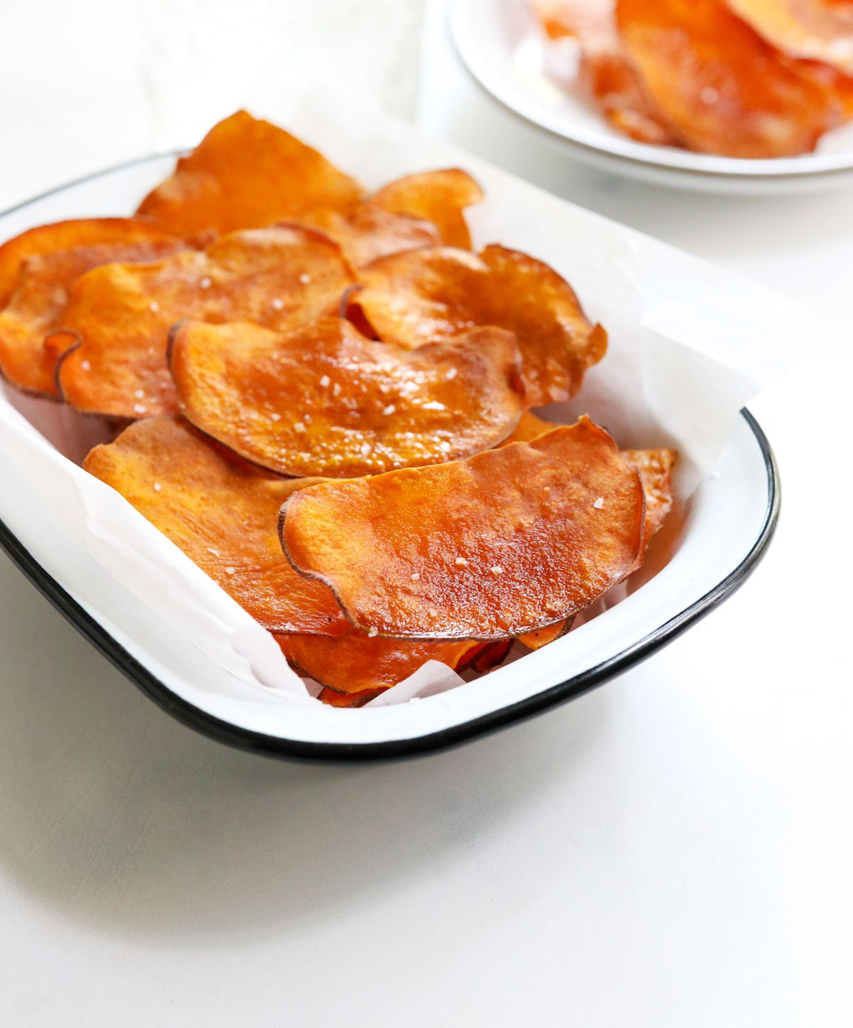sweet potato chips from the side in a white bowl