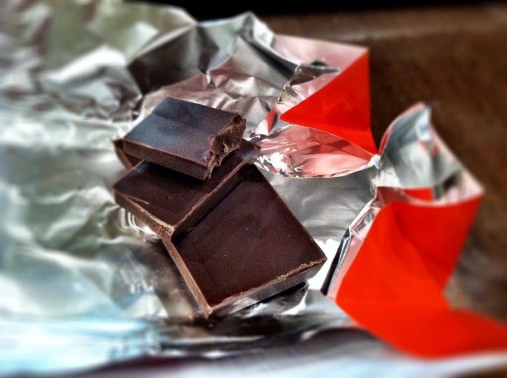 three pieces of dark chocolate