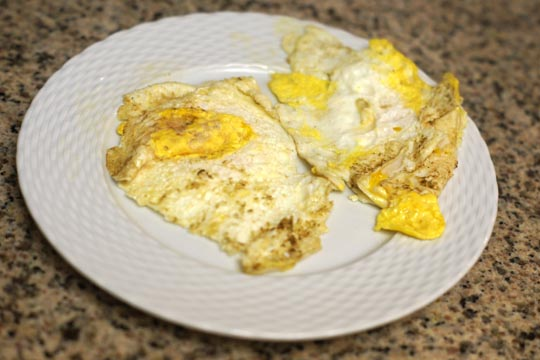 a plate with two fried eggs