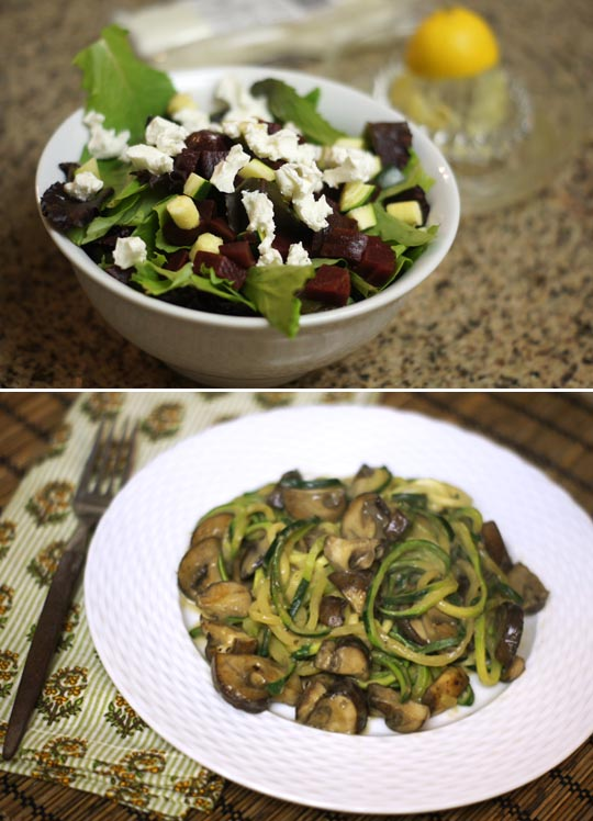 bowl of salad with goat cheese on top and a plate of zucchini noodles