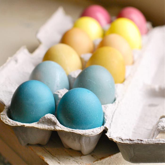 dyed eggs in an egg carton