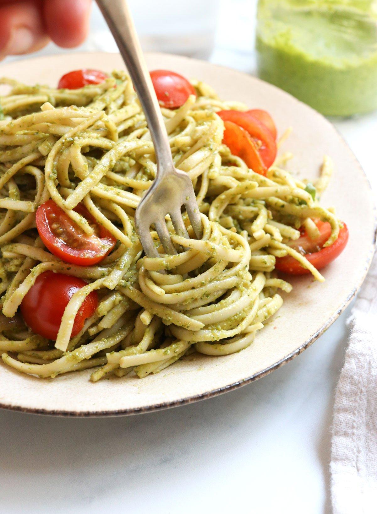 pesto pasta twirled on fork