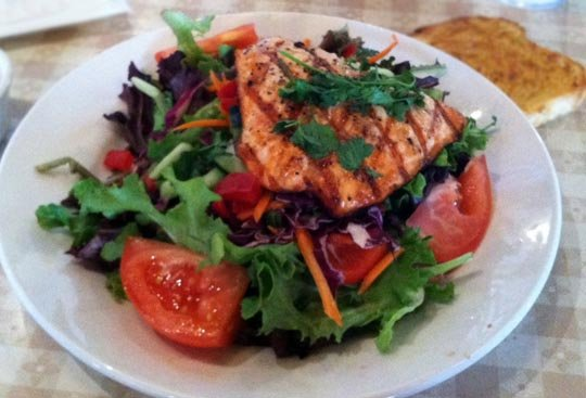 salad with grilled salmon on top