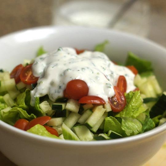 salad in a bowl with goat yogurt