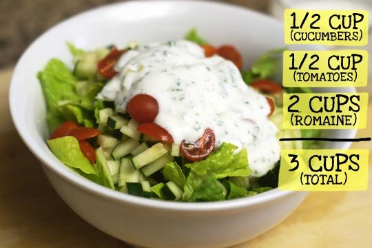 salad in a bowl with dressing on the top