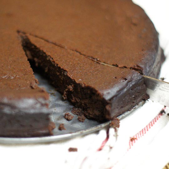 Flourless Chocolate Cake With A Piece Cut Out Of It
