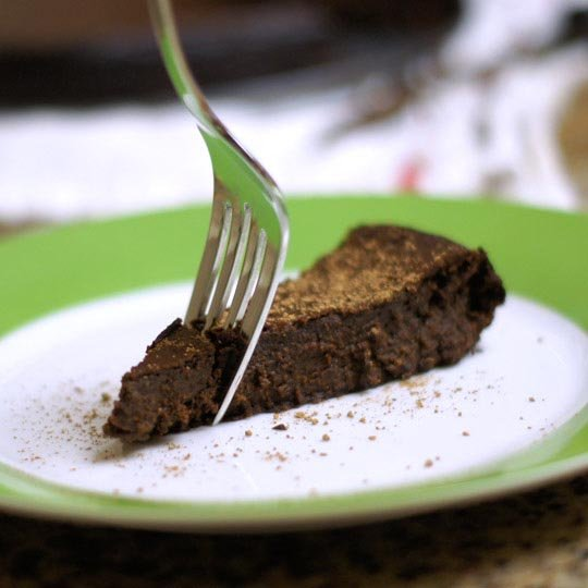 slice of flourless chocolate cake on a plate