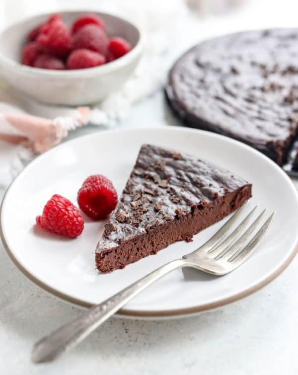 Healthy flourless chocolate cake slice on a plate