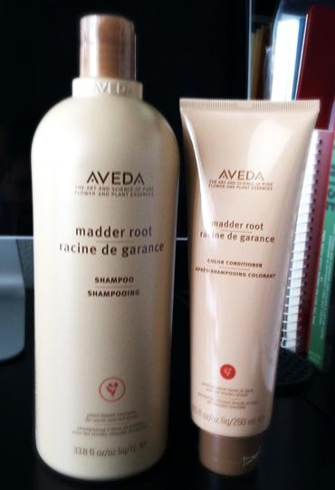 Aveda shampoo and conditioner bottles