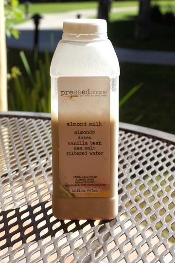 bottle of pressed juicery almond milk