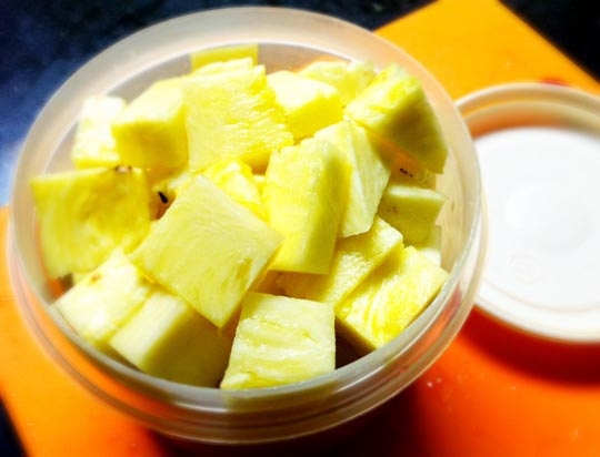 pineapple chunks in a small bowl